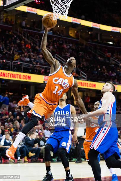DeAndre Liggins of the Cleveland Cavaliers is fouled by Nik Stauskas of the Philadelphia 76ers during the second half at Quicken Loans Arena on March...