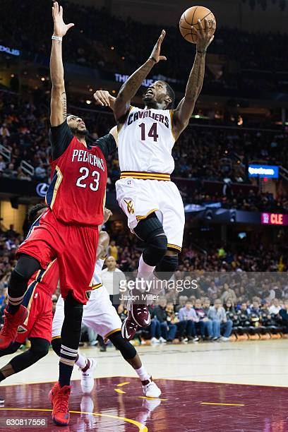 DeAndre Liggins of the Cleveland Cavaliers tries to shoot over Anthony Davis of the New Orleans Pelicans during the second half at Quicken Loans...