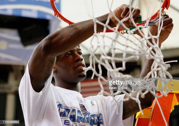 Deandre Liggins of the Kentucky Wildcats cuts down the net after their 70 to 54 win over the Florida Gators in the championship game of the SEC Men's...