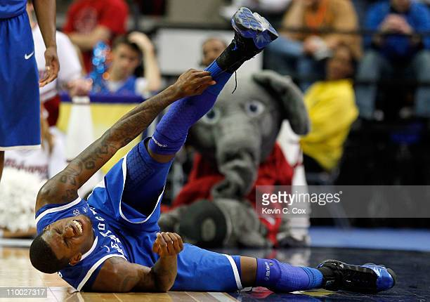 DeAndre Liggins of the Kentucky Wildcats lies on the court injured during their game against the Alabama Crimson Tide in the semifinals of the SEC...