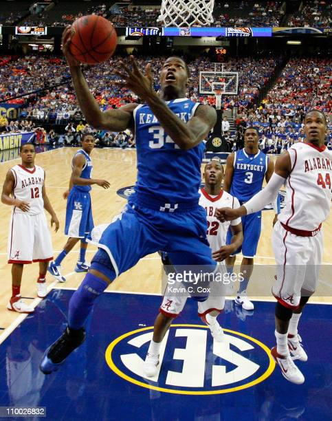 DeAndre Liggins of the Kentucky Wildcats shoots against the Alabama Crimson Tide during the semifinals of the SEC Men's Basketball Tournament at...