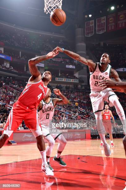 Deandre Liggins of the Milwaukee Bucks and PJ Tucker of the Houston Rockets react to a play on December 16 2017 at the Toyota Center in Houston Texas...