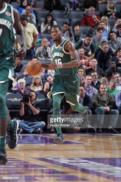 Deandre Liggins of the Milwaukee Bucks brings the ball up the court against the Sacramento Kings on November 28 2017 at Golden 1 Center in Sacramento...