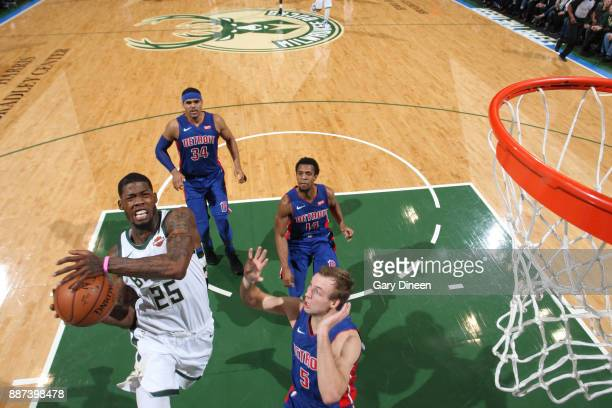 DeAndre Liggins of the Milwaukee Bucks goes to the basket against the Detroit Pistons on December 6 2017 at the BMO Harris Bradley Center in...