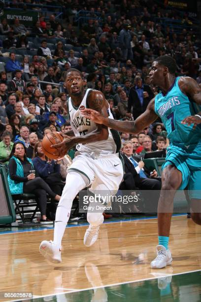 DeAndre Liggins of the Milwaukee Bucks handles the ball against the Charlotte Hornets on October 23 2017 at the BMO Harris Bradley Center in...