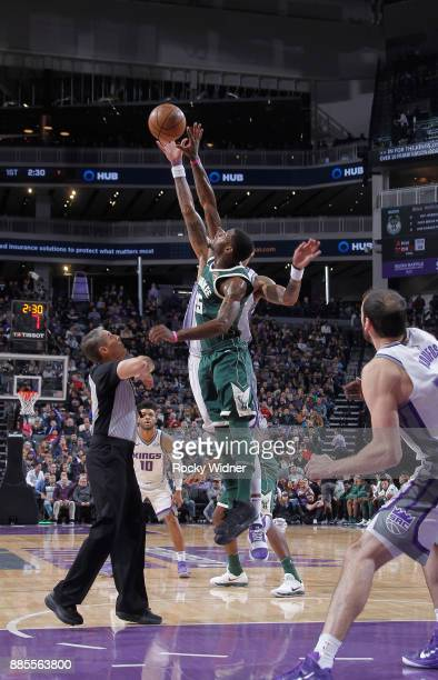 Deandre Liggins of the Milwaukee Bucks jumps for the ball against the Sacramento Kings on November 28 2017 at Golden 1 Center in Sacramento...