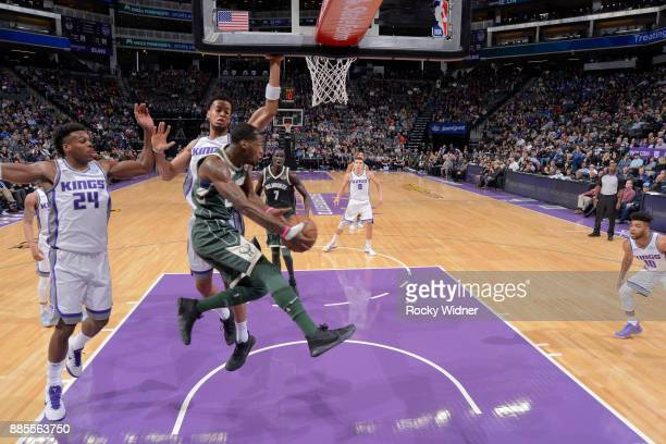 Deandre Liggins of the Milwaukee Bucks passes against Skal Labissiere of the Sacramento Kings on November 28 2017 at Golden 1 Center in Sacramento...