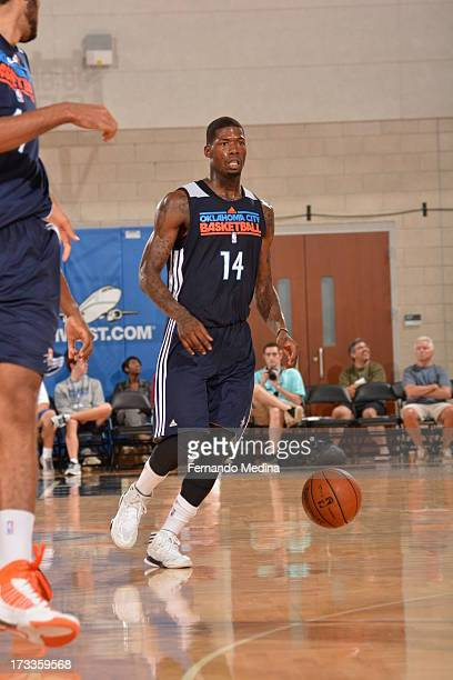 DeAndre Liggins of the Oklahoma City Thunder controls the ball against the Houston Rockets during the 2013 Southwest Airlines Orlando Pro Summer...