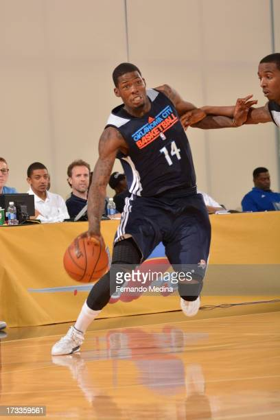 DeAndre Liggins of the Oklahoma City Thunder drives against the Houston Rockets during the 2013 Southwest Airlines Orlando Pro Summer League on July...
