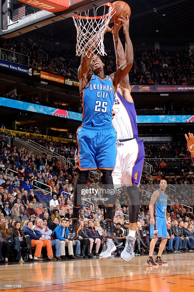 DeAndre Liggins #25 of the Oklahoma City Thunder reaches for a rebound against the Phoenix Suns on January 14, 2013 at U.S. Airways Center in Phoenix, Arizona.