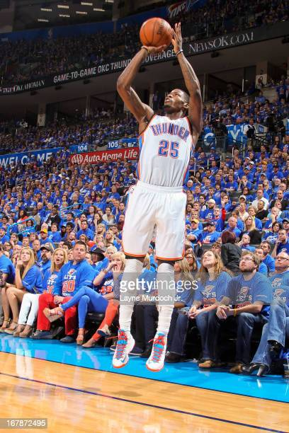 DeAndre Liggins of the Oklahoma City Thunder shoots a threepointer against the Houston Rockets in Game Five of the Western Conference Quarterfinals...