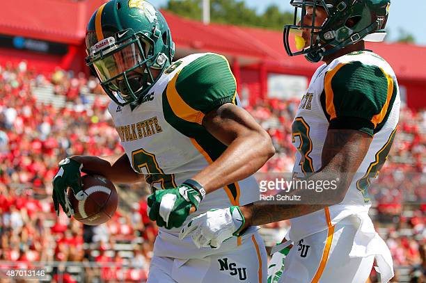 DeAndre Sangster of the Norfolk State Spartans celebrates his touchdown catch with teammate Thomas Stinger against the Rutgers Scarlet Knights during...