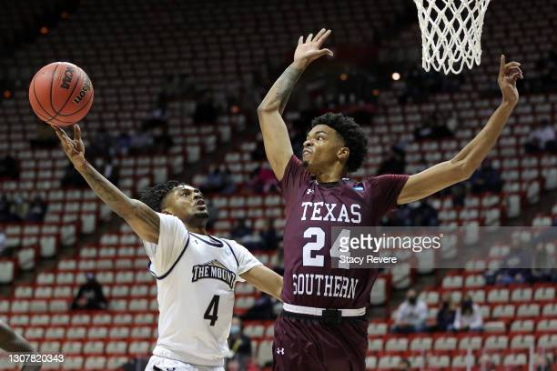 Deandre Thomas of the Mount St. Mary's Mountaineers shoots against John Walker III of the Texas Southern Tigers during the first half in a First Four...