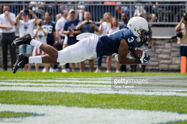 DeAndre Thompkins of the Penn State Nittany Lions catches a pass for a touchdown against the Kent State Golden Flashes during the first half at...