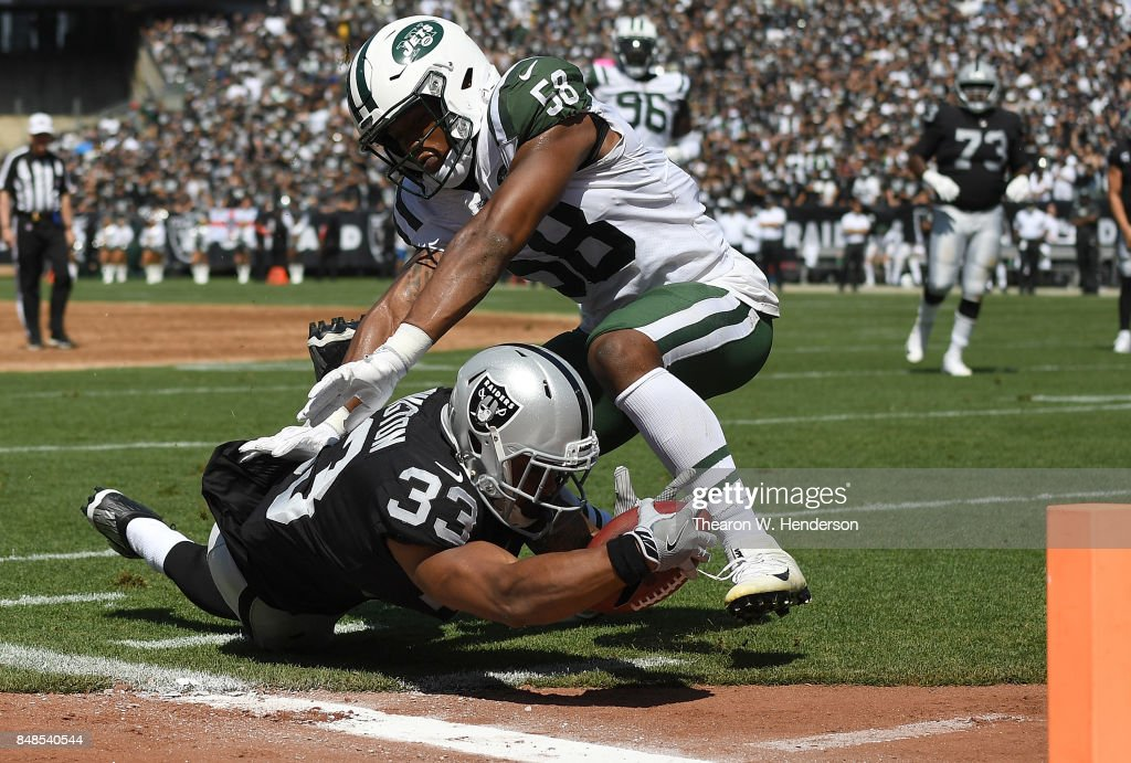 DeAndre Washington #33 of the Oakland Raiders gets tackled at the one yard line by Darron Lee #58 of the New York Jets during the first quarter of their NFL football game at Oakland-Alameda County Coliseum on September 17, 2017 in Oakland, California.