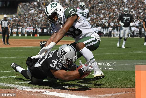 DeAndre Washington of the Oakland Raiders gets tackled at the one yard line by Darron Lee of the New York Jets during the first quarter of their NFL...