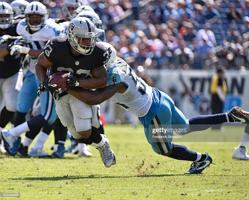 DeAndre Washington #33 of the Oakland Raiders rushes against the Tennessee Titans during the first half at Nissan Stadium on September 25, 2016 in Nashville, Tennessee.