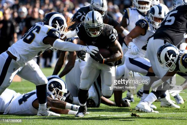 DeAndre Washington of the Oakland Raiders rushes for a touchdown against the Los Angeles Rams during their NFL preseason game at RingCentral Coliseum...