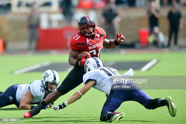 DeAndre Washington of the Texas Tech Red Raiders tries to get around Michael Downing of the TCU Horned Frogs on September 26, 2015 at Jones AT&T...