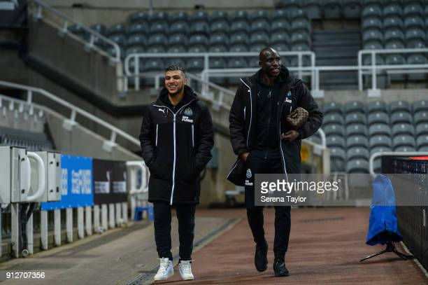 DeAndre Yedlin and Mohamed Diame of Newcastle United arrive prior to kick off of The Premier League match between Newcastle United and Burnley at...