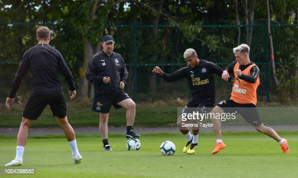 DeAndre Yedlin controls the ball whilst being challenged by Matt Ritchie whist Newcastle United Manager Rafael Benitez watches on during the...