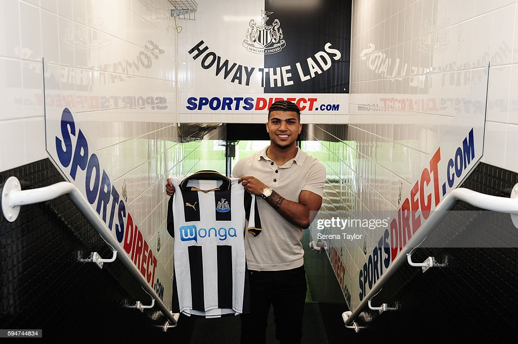 DeAndre Yedlin holds a club shirt in the tunnel after signing a 5 year contract at St.James' Park on August 24, 2016, in Newcastle upon Tyne, England.