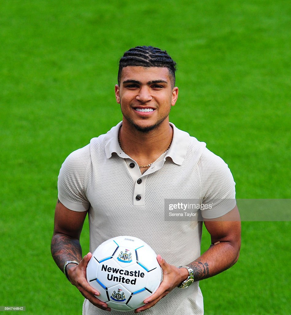 DeAndre Yedlin holds a football on the pitch after signing a 5 year contract at St.James' Park on August 24, 2016, in Newcastle upon Tyne, England.