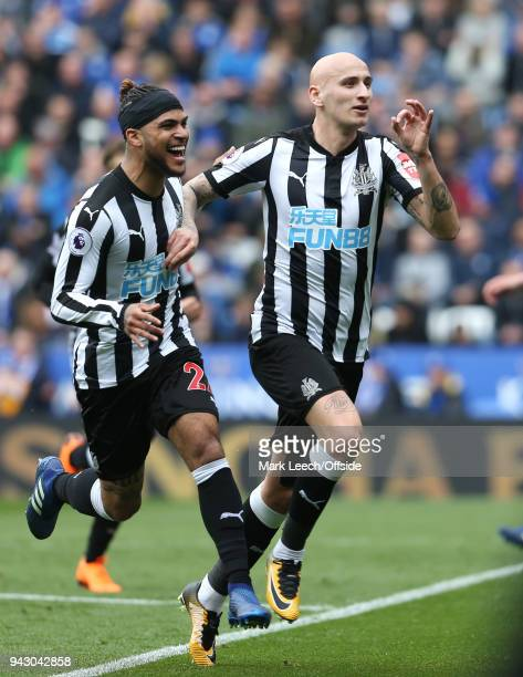 DeAndre Yedlin of Newcastle celebrates the opening goal with scorer Jonjo Shelvey of Newcastle during the Premier League match between Leicester City...