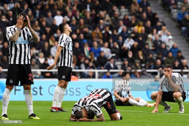 Deandre Yedlin of Newcastle United and his teammates look dejected as Deandre Yedlin of Newcastle United scores an own goal Chelsea's second goal...