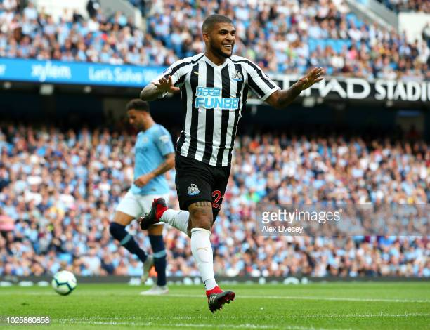 Deandre Yedlin of Newcastle United celebrates after scoring his team's first goal during the Premier League match between Manchester City and...