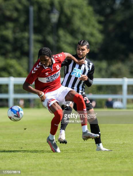 DeAndre Yedlin of Newcastle United FC challenges Djed Spence of Middlesbrough FC for the ball during the Pre Season Friendly between Newcastle United...