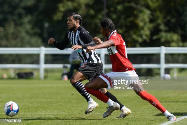 DeAndre Yedlin of Newcastle United FC looks to cross the ball whilst being challenged by Djed Spence of Middlesbrough FC during the Pre Season...
