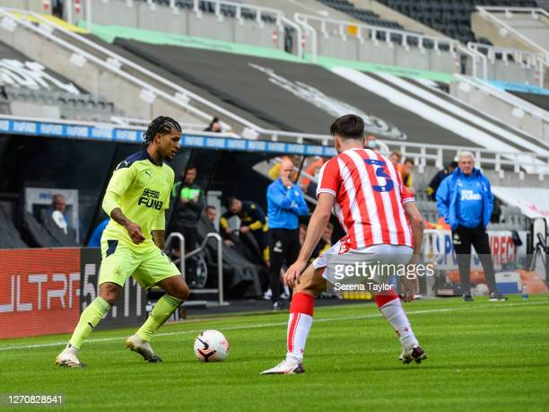 DeAndre Yedlin of Newcastle United FC looks to pass the ball as Morgan Fox of Stoke City defends during the Pre Season Friendly between Newcastle...