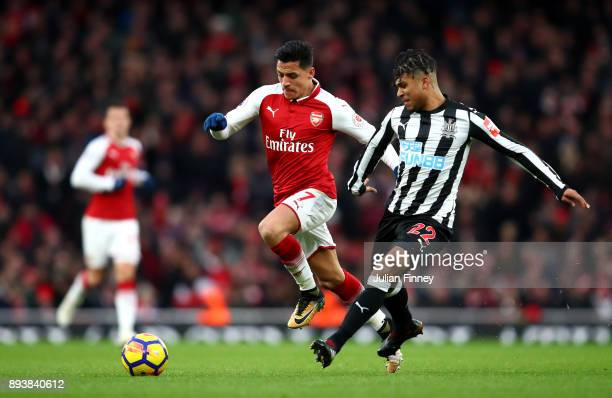 Deandre Yedlin of Newcastle United is challenged by Alexis Sanchez of Arsenal during the Premier League match between Arsenal and Newcastle United at...