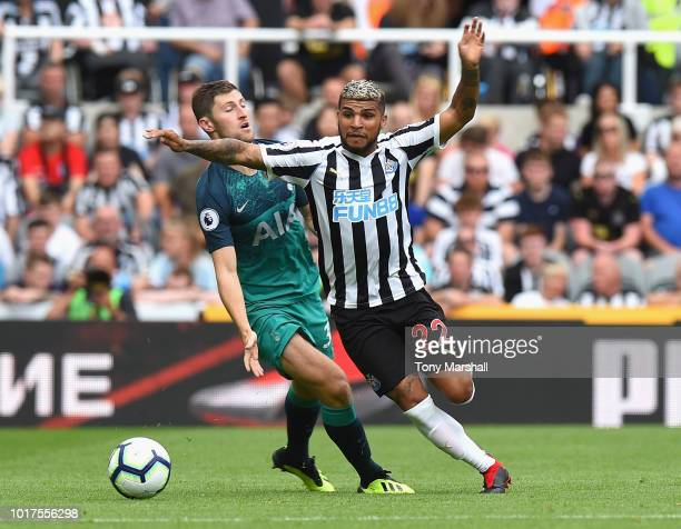 DeAndre Yedlin of Newcastle United is challenged by Ben Davies of Tottenham Hotspur during the Premier League match between Newcastle United and...