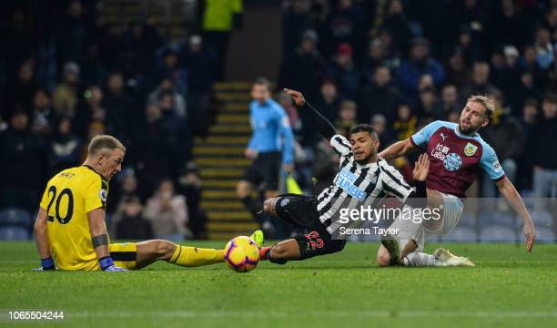DeAndre Yedlin of Newcastle United is challenged by Charlie Taylor in the box of Burnley FC , also seen is Burnley FC Goalkeeper Joe Hart during the...