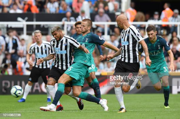 Deandre Yedlin of Newcastle United is challenged by Eric Dier of Tottenham Hotspur during the Premier League match between Newcastle United and...