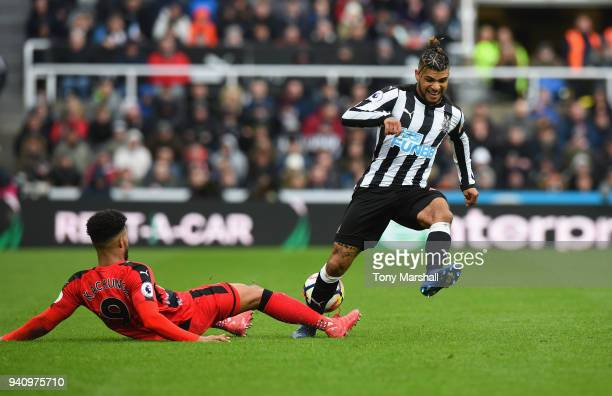 DeAndre Yedlin of Newcastle United is tackled by Elias Kachunga of Huddersfield Town during the Premier League match between Newcastle United and...