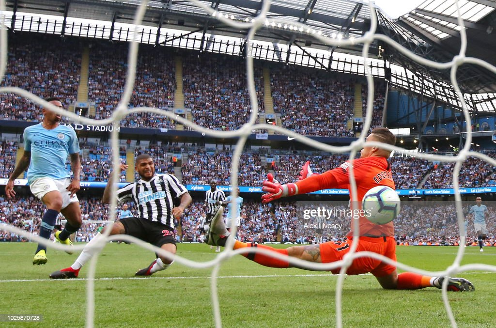 Deandre Yedlin of Newcastle United scores his team's first goal past Ederson of Manchester City during the Premier League match between Manchester City and Newcastle United at Etihad Stadium on September 1, 2018 in Manchester, United Kingdom.