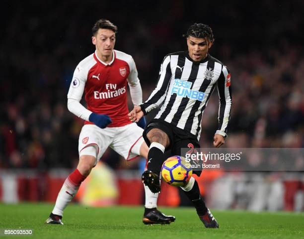 DeAndre Yedlin of Newcastle United shields the ball from Mezut Ozil of Arsenal during the Premier League match between Arsenal and Newcastle United...