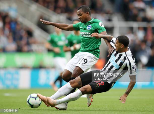 Deandre Yedlin of Newcastle United tackles Jose Izquierdo of Brighton and Hove Albion during the Premier League match between Newcastle United and...