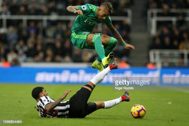Deandre Yedlin of Newcastle United tackles Roberto Pereyra of Watford during the Premier League match between Newcastle United and Watford FC at St....