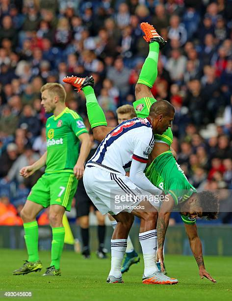 DeAndre Yedlin of Sunderland is held up by Salomon Rondon of West Bromwich Albion during the Barclays Premier League match between West Bromwich...