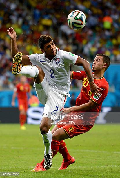 DeAndre Yedlin of the United States and Eden Hazard of Belgium compete for the ball during the 2014 FIFA World Cup Brazil Round of 16 match between...
