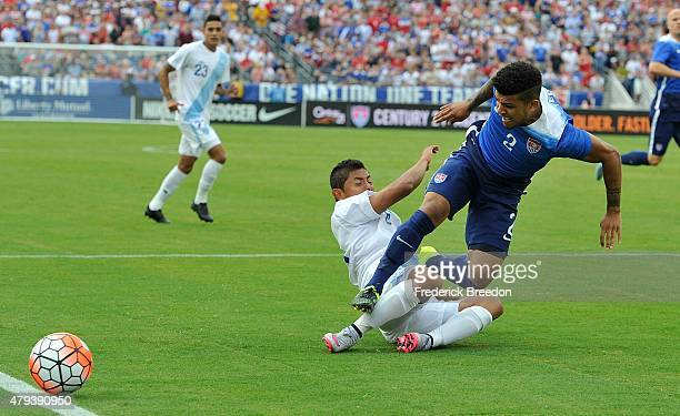 DeAndre Yedlin of the United States gets tripped during the first half of an international friendly soccer match against Guatemala at Nissan Stadium...
