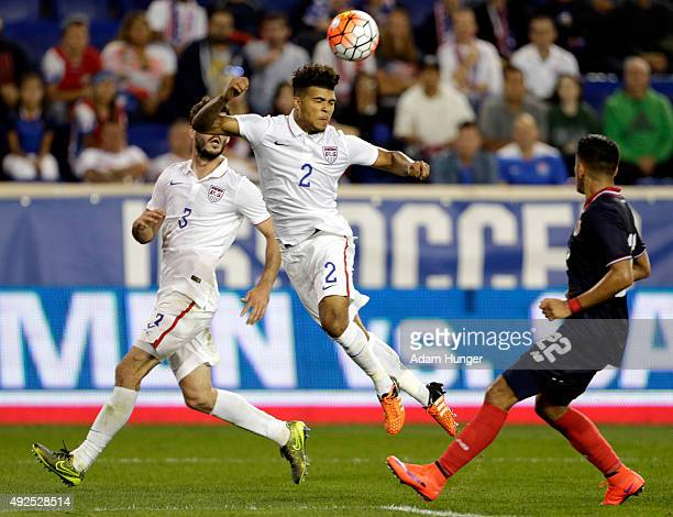 DeAndre Yedlin of the United States heads the ball defended by Ronald Matarrita of Costa Rica during the second half at Red Bull Arena on October 13...