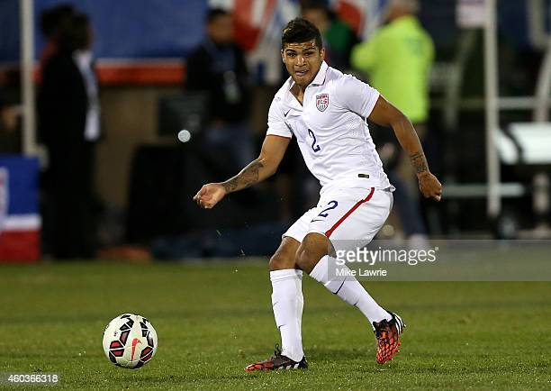 DeAndre Yedlin of the United States makes a pass against Ecuador during an international friendly at Rentschler Field on October 10 2014 in East...