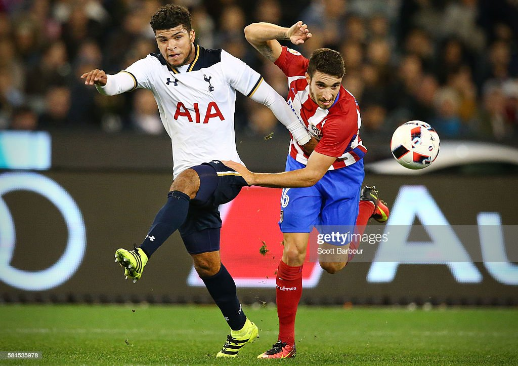 DeAndre Yedlin of Tottenham Hotspur and Sime Vrsaljko of Atletico de Madrid compete for the ball during 2016 International Champions Cup Australia match between Tottenham Hotspur and Atletico de Madrid at the Melbourne Cricket Ground on July 29, 2016 in Melbourne, Australia.