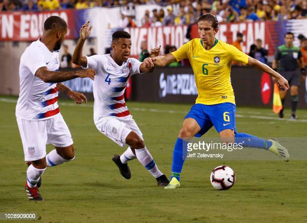 DeAndre Yedlin of USA and Tyler Adams of USA defend Filipe Luís of Brazil during their friendly match at MetLife Stadium on September 7 2018 in East...