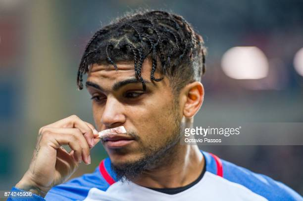 DeAndre Yedlin of USA smells an ammonia inhalant during the International Friendly match between Portugal and USA at Estadio Municipal Leiria on...